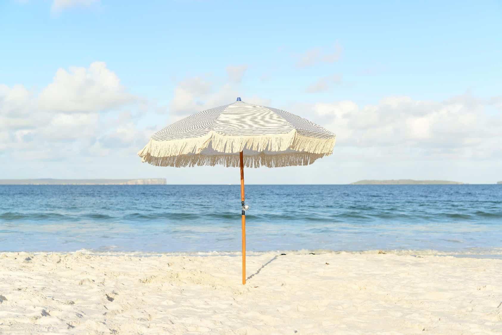 Image of white umbrella on sandy beach