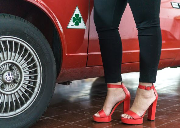 driving in high heels like these red one is dangerous