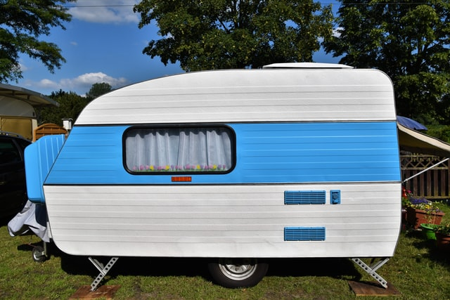 caravan parked and set up at travel site on grass