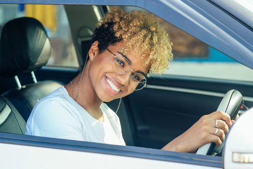 10 tips for first time car buyers would be useful for this teenage girl with glasses sitting in her new car