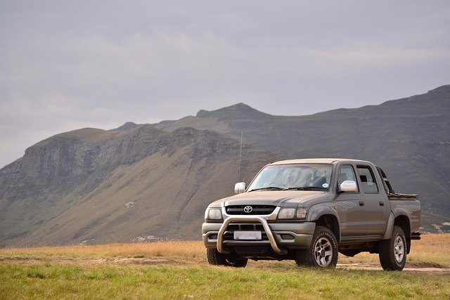 grey high mileage car or ute in front of mountains